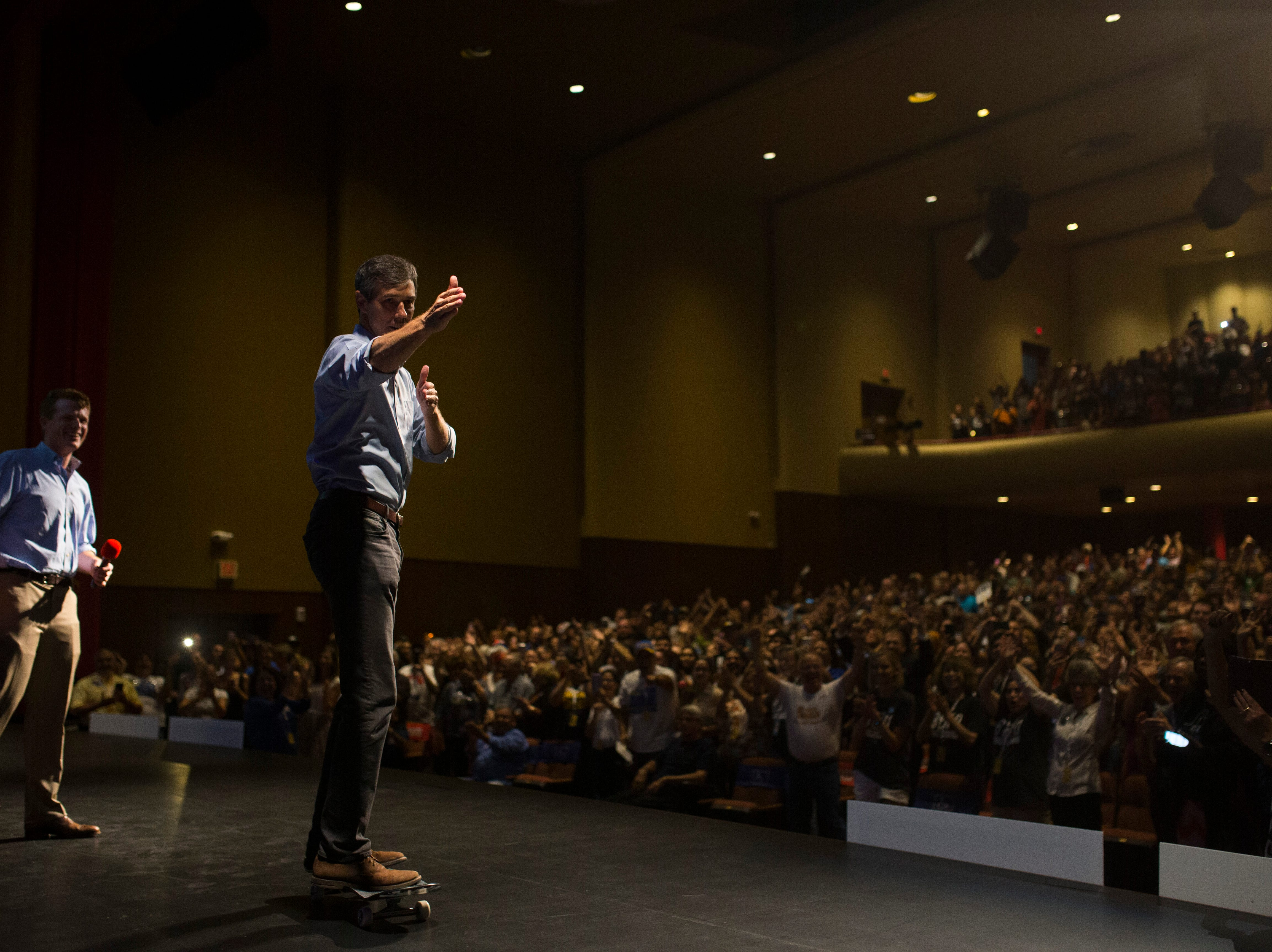 U.S. Rep. Beto O'Rourke skates onto the stage during a campaign event on Saturday, Oct. 13, 2018 at Del Mar College in Corpus Christi.