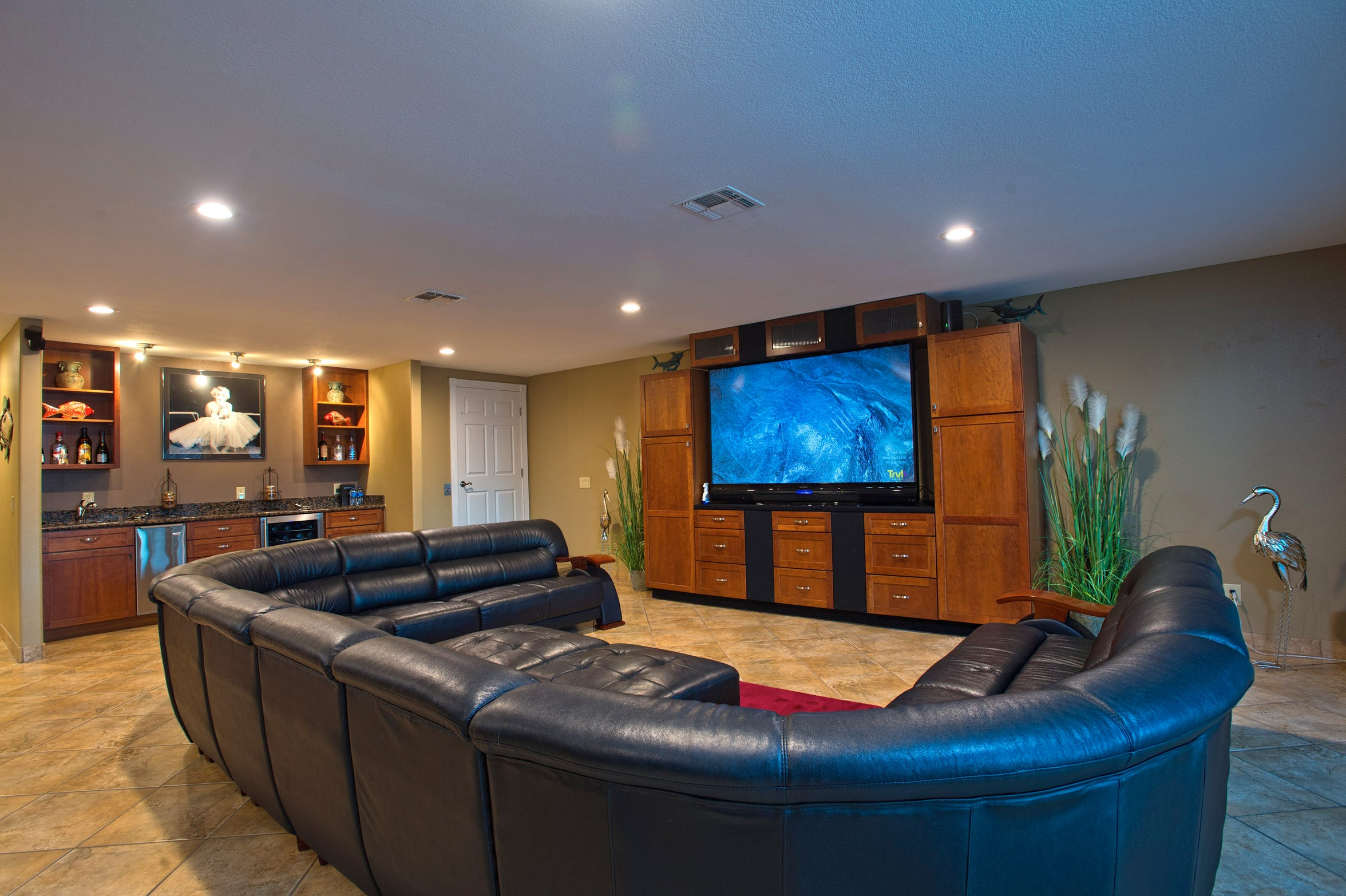 The large open living space on the first floor is anchored by a granite topped wet bar with built ins