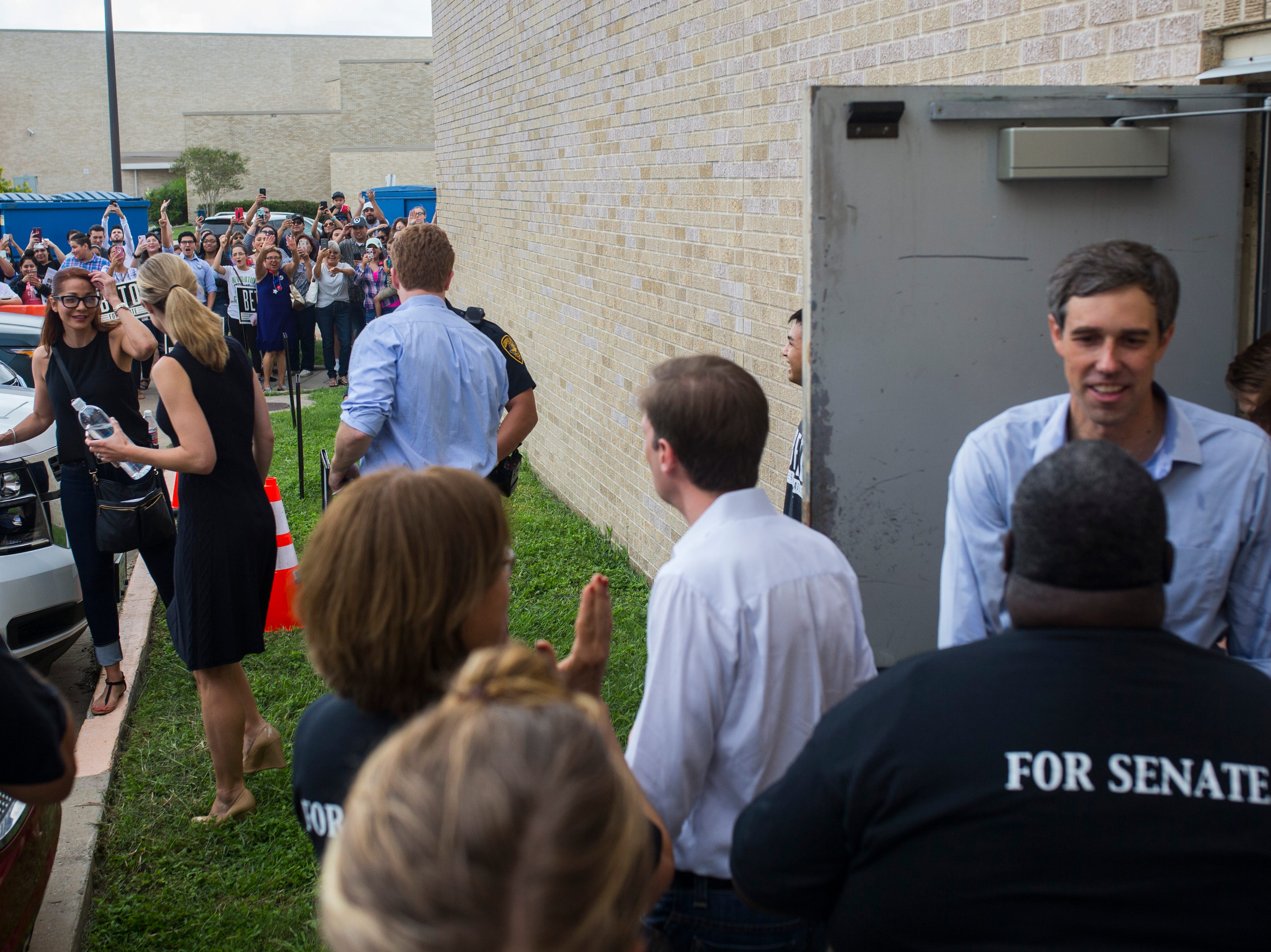 Beto O'Rourke supporters wave to him following a campaign event Saturday, Oct. 13, 2018 at Del Mar College in Corpus Christi.