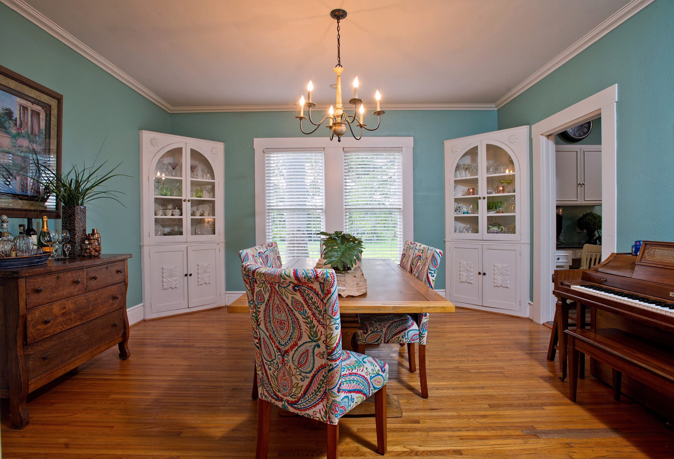 The dining room is spacious and has the original hardwood floors and corner built ins
