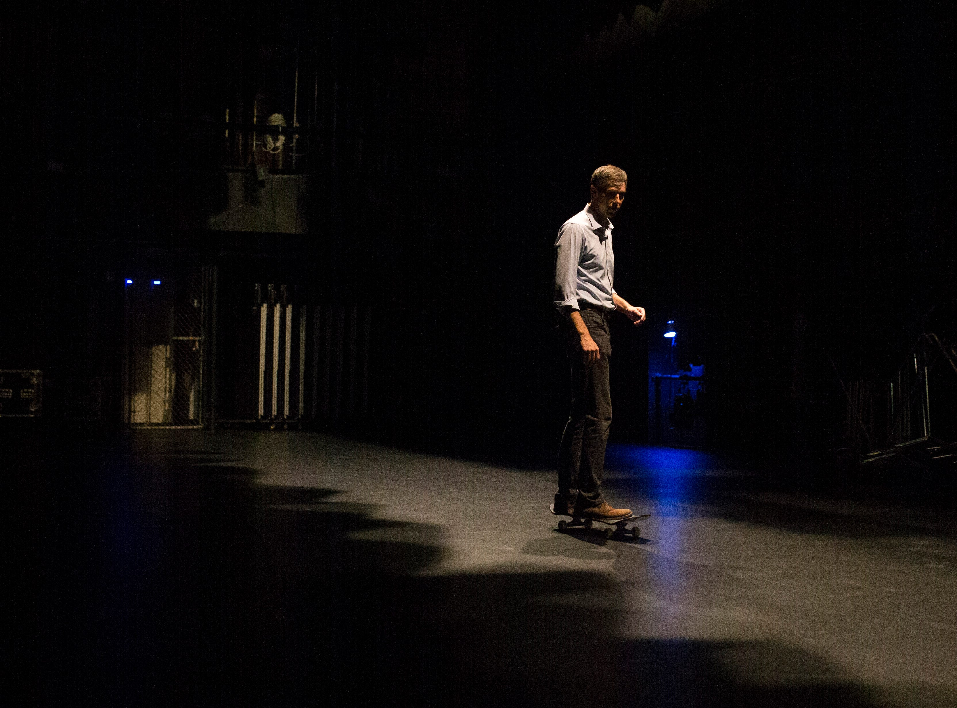 U.S. Rep. Beto O'Rourke skates on a skateboard behind stage before speaking at campaign event on Saturday, Oct. 13, 2018 at Del Mar College in Corpus Christi.