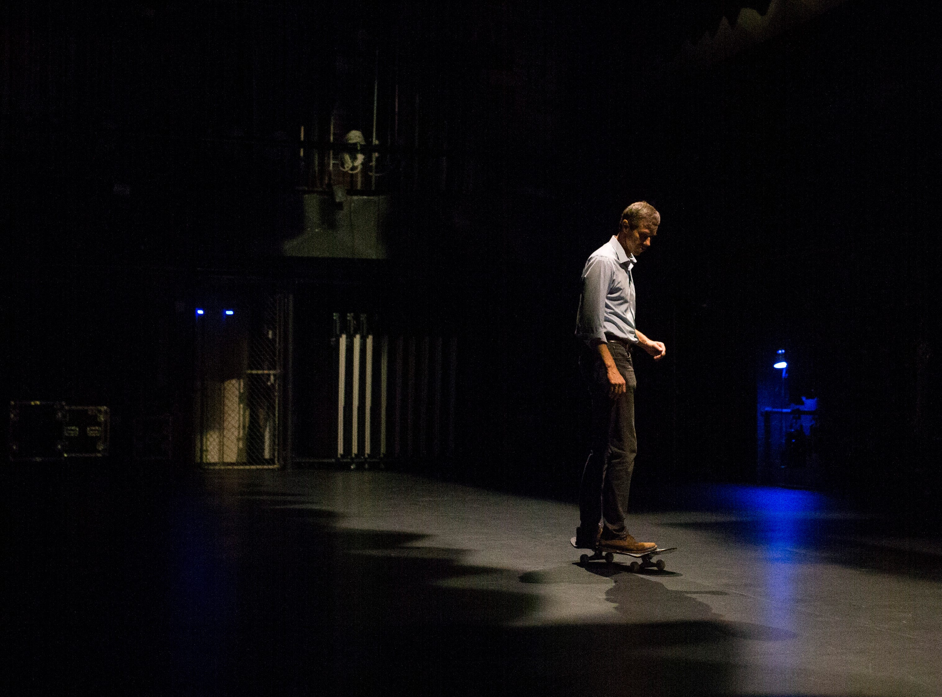 U.S. Rep. Beto O'Rourke skates on a skateboard behind stage before speaking at a campaign event on Saturday, Oct. 13, 2018 at Del Mar College in Corpus Christi.