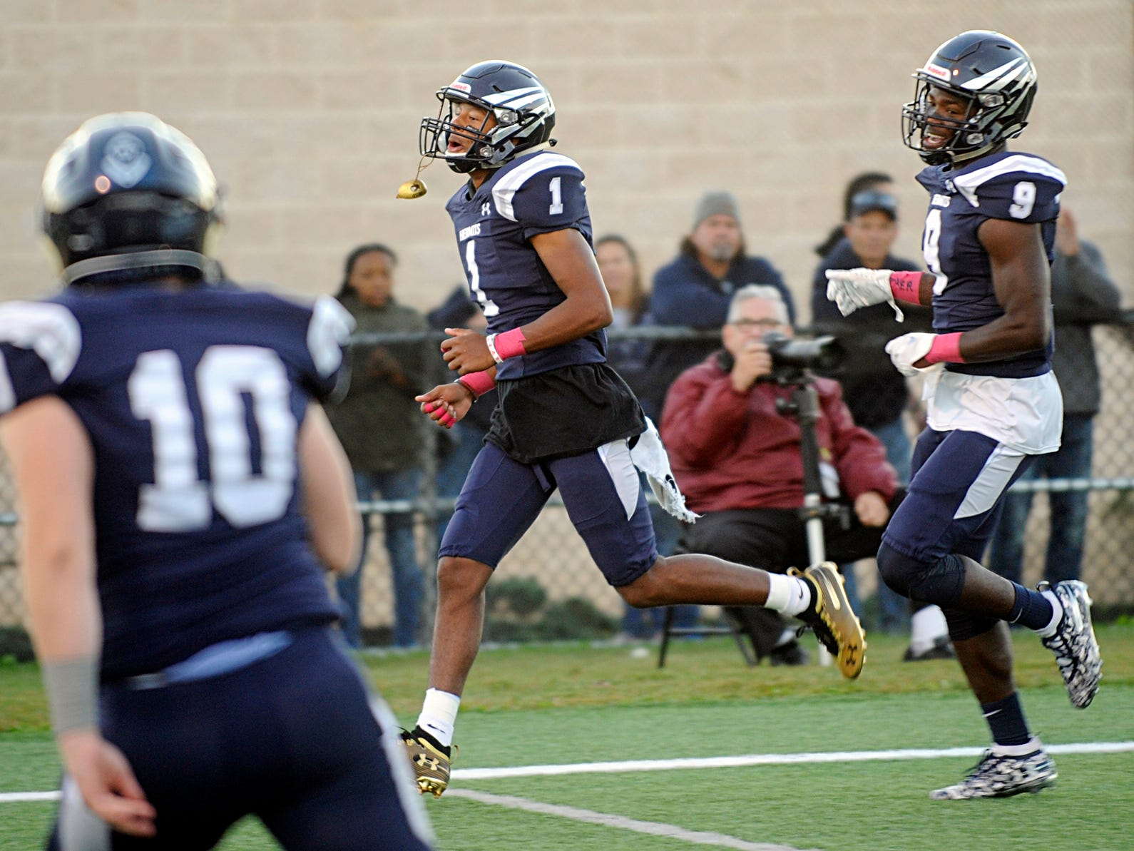 St. Augustine's Justin Shorter celebrates after scoring a touchdown against Holy Spirit. The Hermits defeated the visiting Spartans, 27-14 on Friday, October 12, 2018.