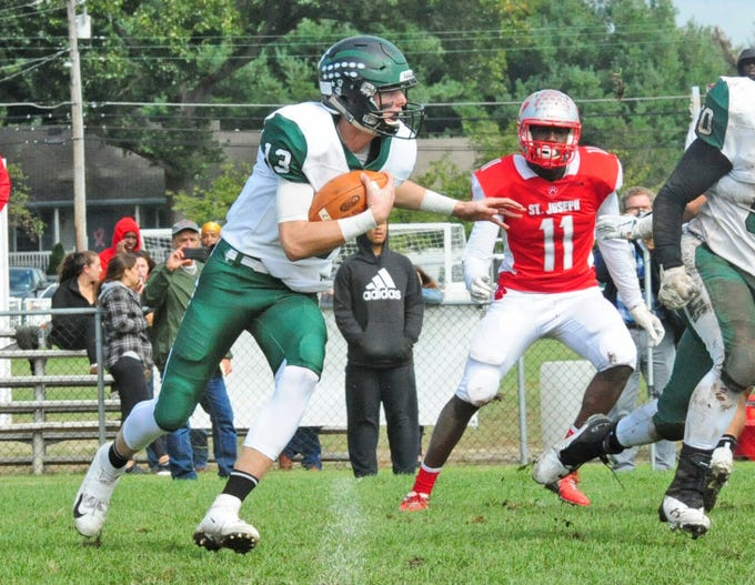 West Deptford's Aaron Graeber looks for running room against St. Joseph in Hammonton on Saturday, October 13, 2018.