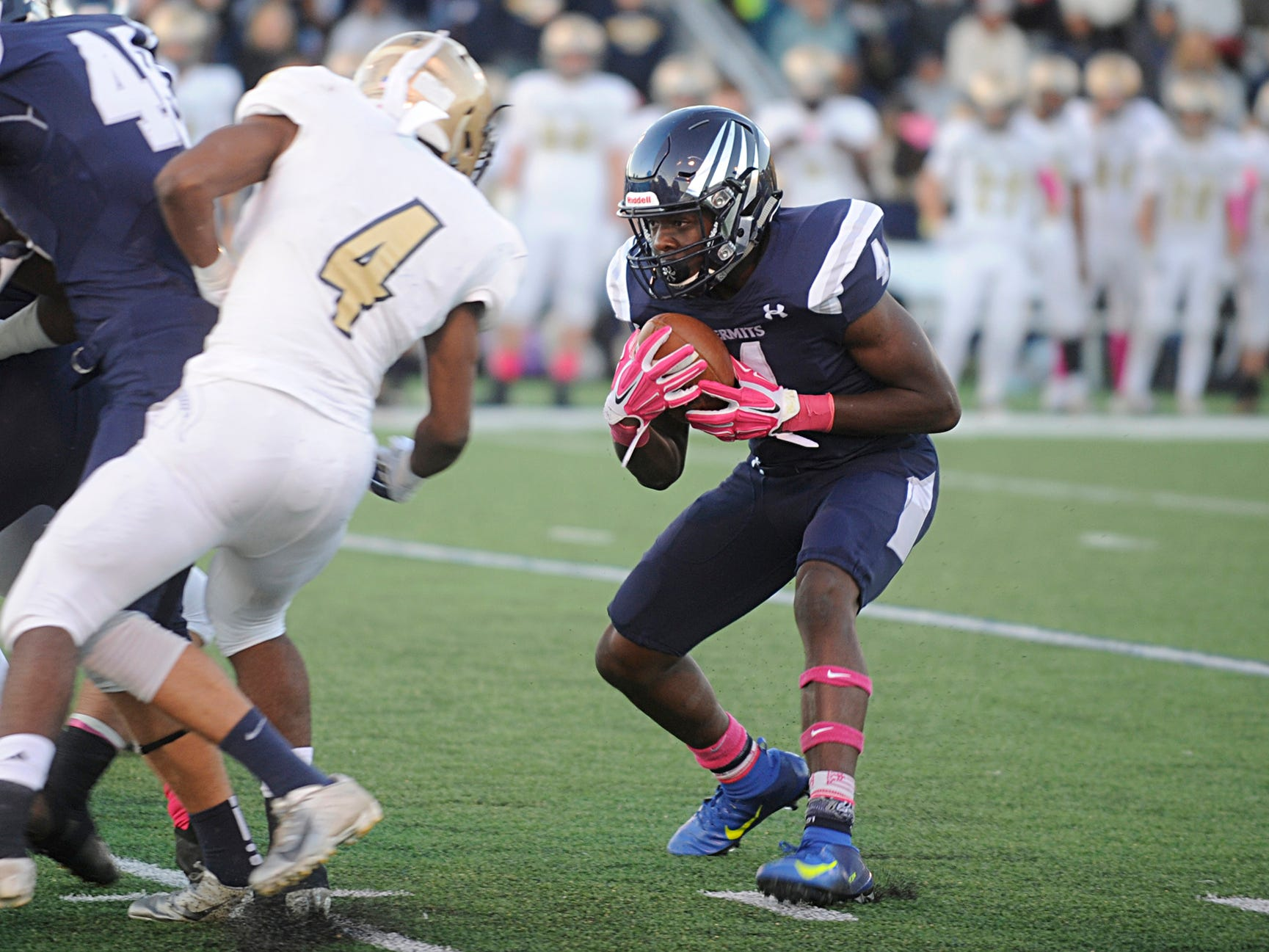 St. Augustine's Nasir Hill runs for a gain during a game against Holy Spirit. The Hermits defeated the visiting Spartans, 27-14 on Friday, October 12, 2018.