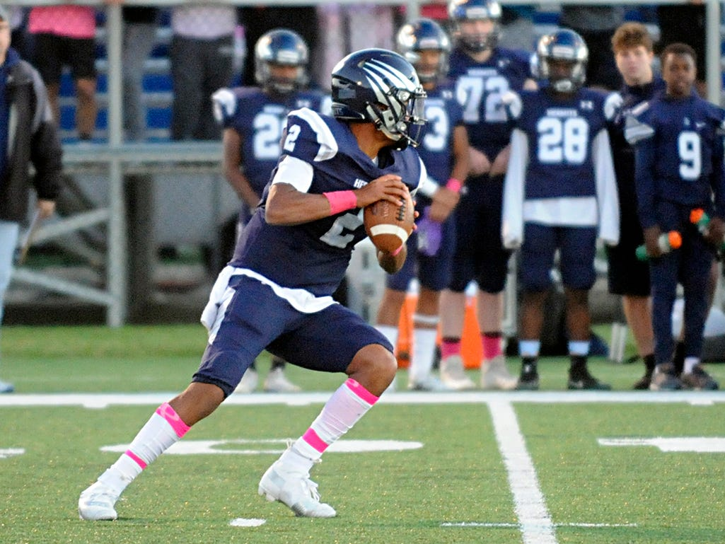 St. Augustine's QB, Chris Allen looks downfield during a game against Holy Spirit. The Hermits defeated the visiting Spartans, 27-14 on Friday, October 12, 2018.