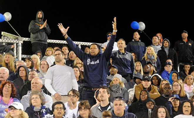 St. Augustine fans react to a questionable call during the third quarter in Richland. The Hermits defeated the Spartans, 27-14.