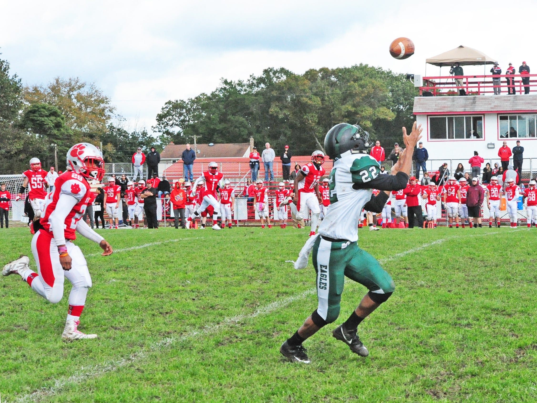 West Deptford's Donovan Stone prepares to haul in a long pass which he ran for a touchdown against St. Joseph in Hammonton on Saturday, October 13, 2018.