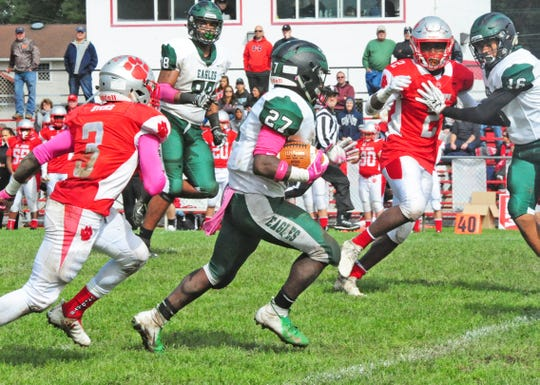 West Deptford's Tyshawn Bookman (center) breaks away for a long touchdown run against St. Joseph at Hammonton on Saturday, October 13, 2018.