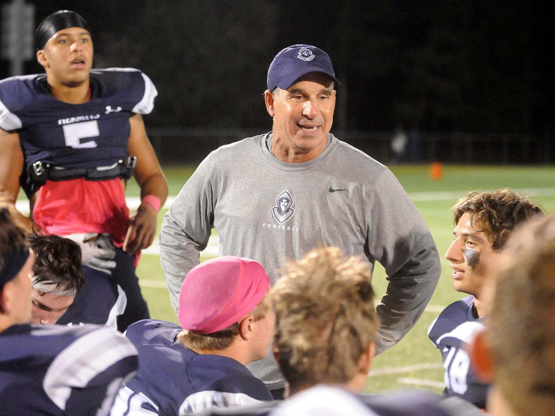 Coach Pete Lancetta speaks to the Hermits after a big win over the Spartans. St. Augustine topped visiting Holy Spirit 27-14 in Richland on Friday, October 12, 2018.