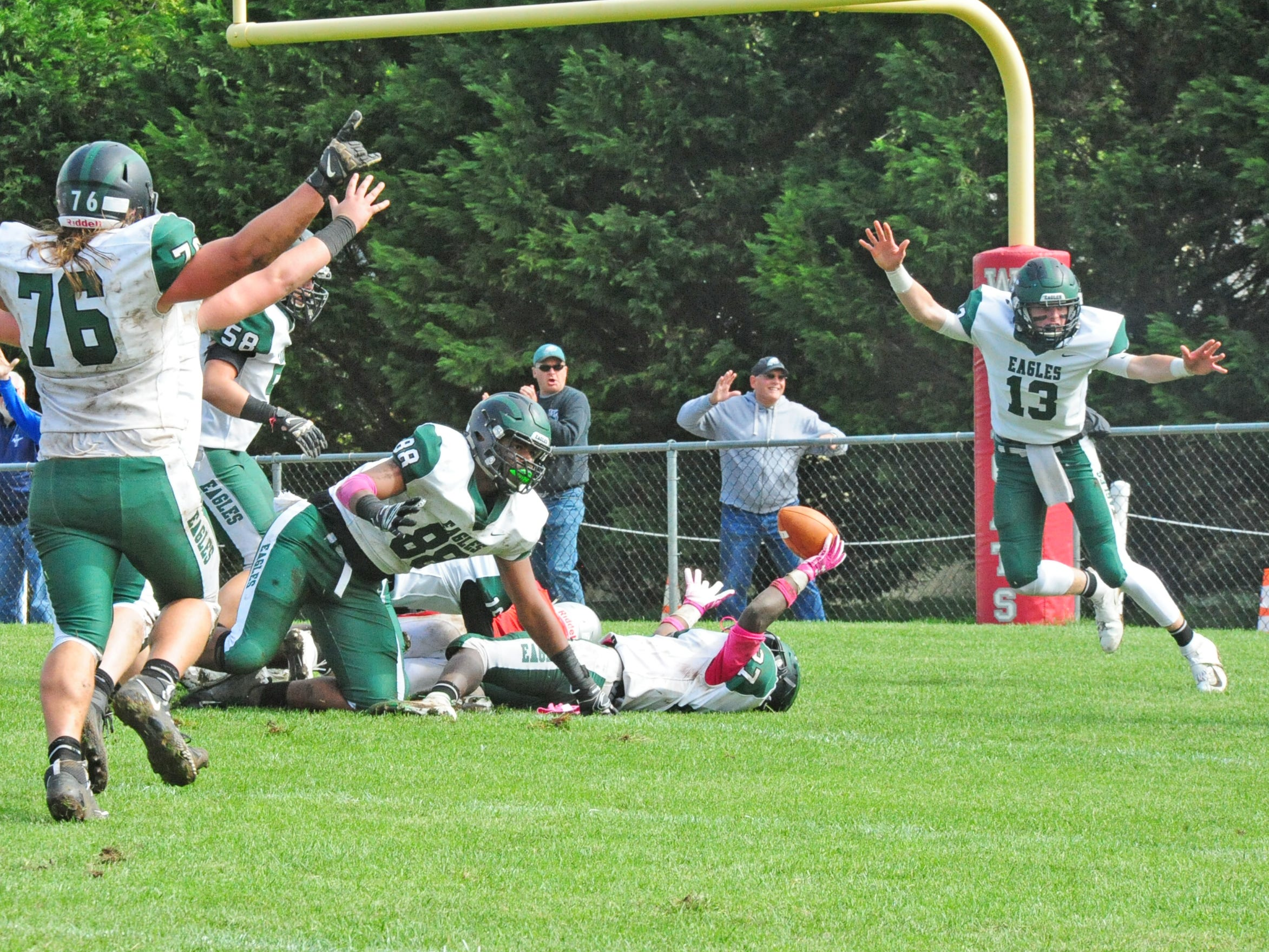 West Deptford celebrates a touchdown by Tyshawn Bookman (on ground, center) against St. Joseph at Hammonton in Saturday, October 13, 2018.