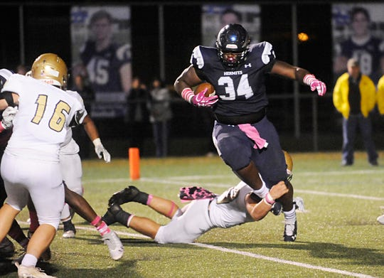 St. Augustine's Isaiah Raikes runs for a gain against Holy Spirit. The Hermits defeated the visiting Spartans, 27-14 on Friday, October 12, 2018.