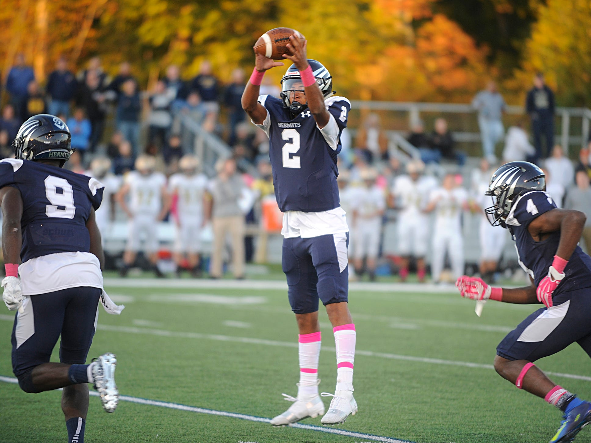 St. Augustine's QB, Chris Allen grabs a high snap during a game against Holy Spirit. The Hermits defeated the visiting Spartans, 27-14 on Friday, October 12, 2018.