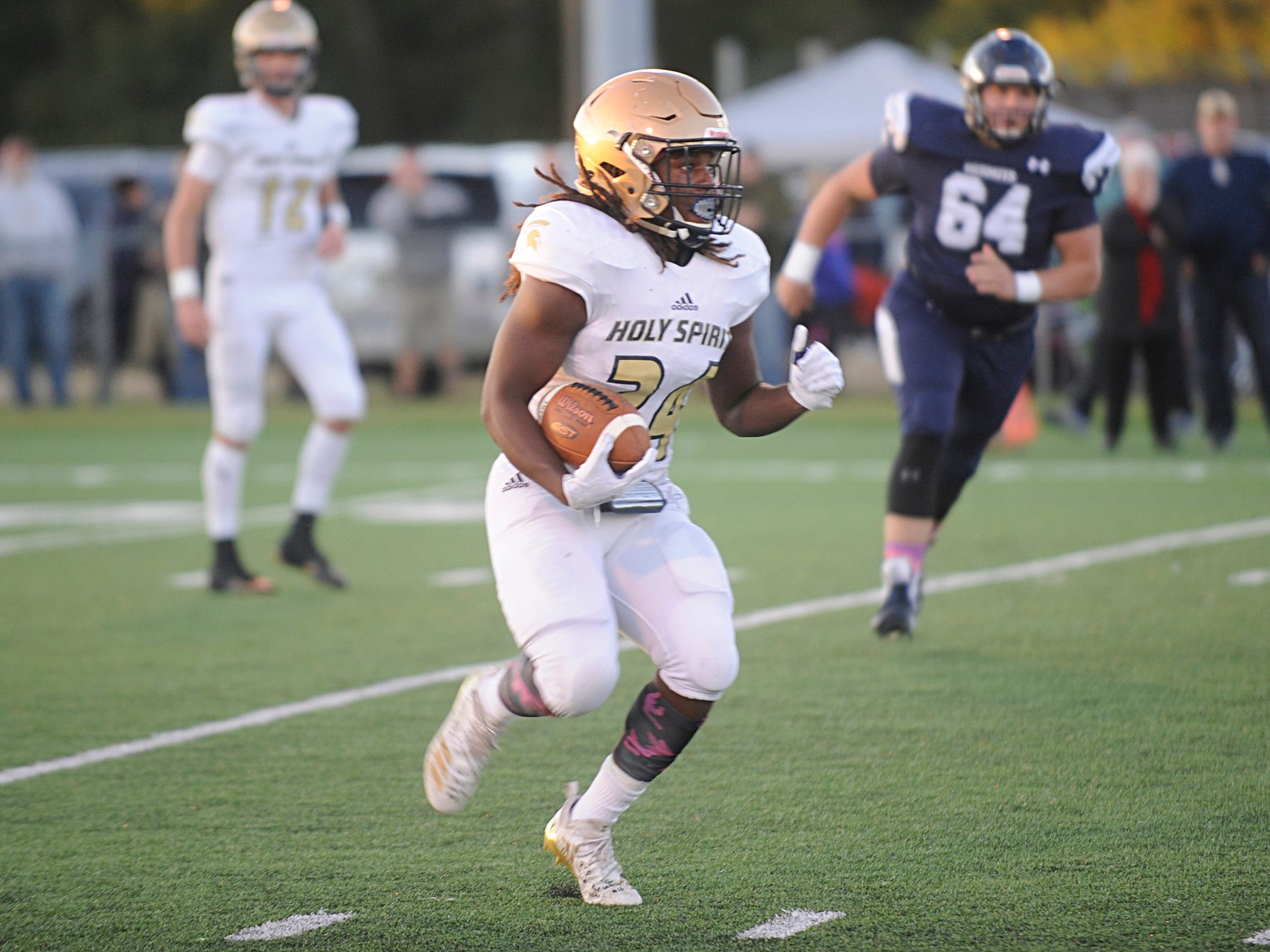 Holy Spirit's E'lijah Gray runs for a gain against St. Augustine. The Hermits topped the Spartans, 27-14 in Richland on Friday, October 12, 2018.