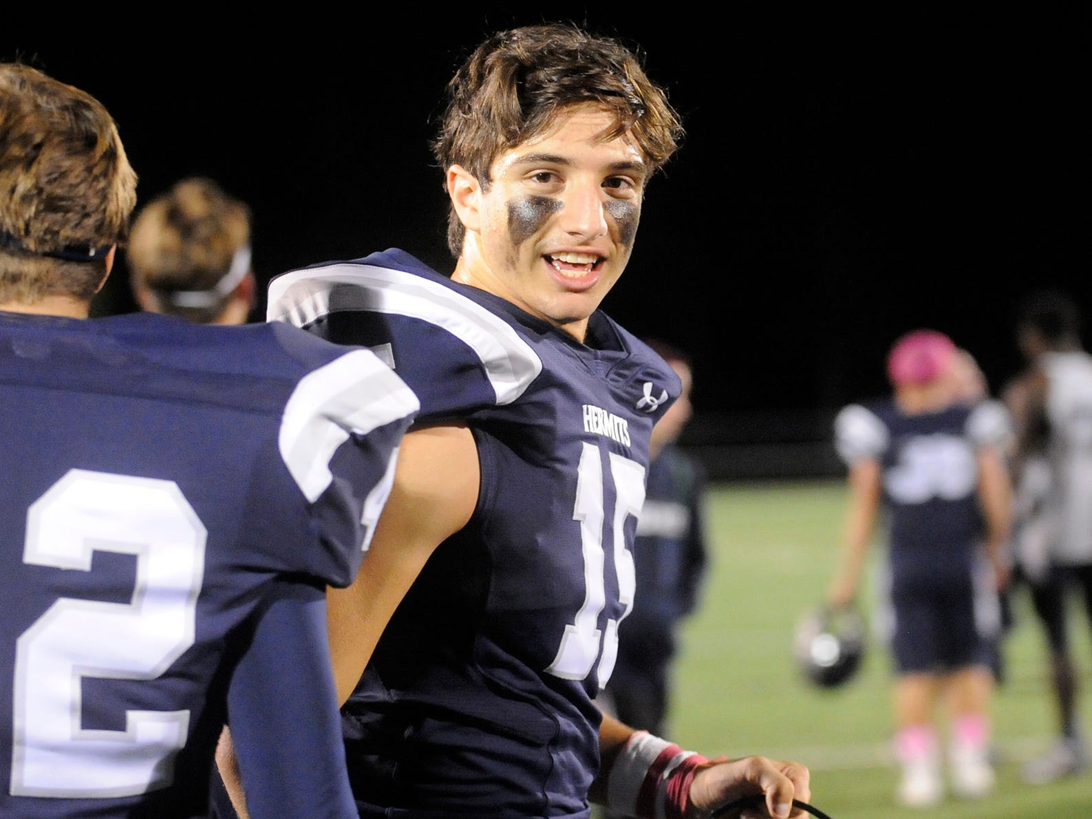St. Augustine's Joey Kolonich celebrates a team win over Holy Spirit. The Hermits defeated the visiting Spartans, 27-14.