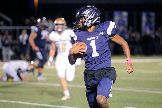St. Augustine's Justin Shorter runs for a gain against visiting Holy Spirit. The Hermits defeated the Spartans, 27-14 on Friday, October 12, 2018.