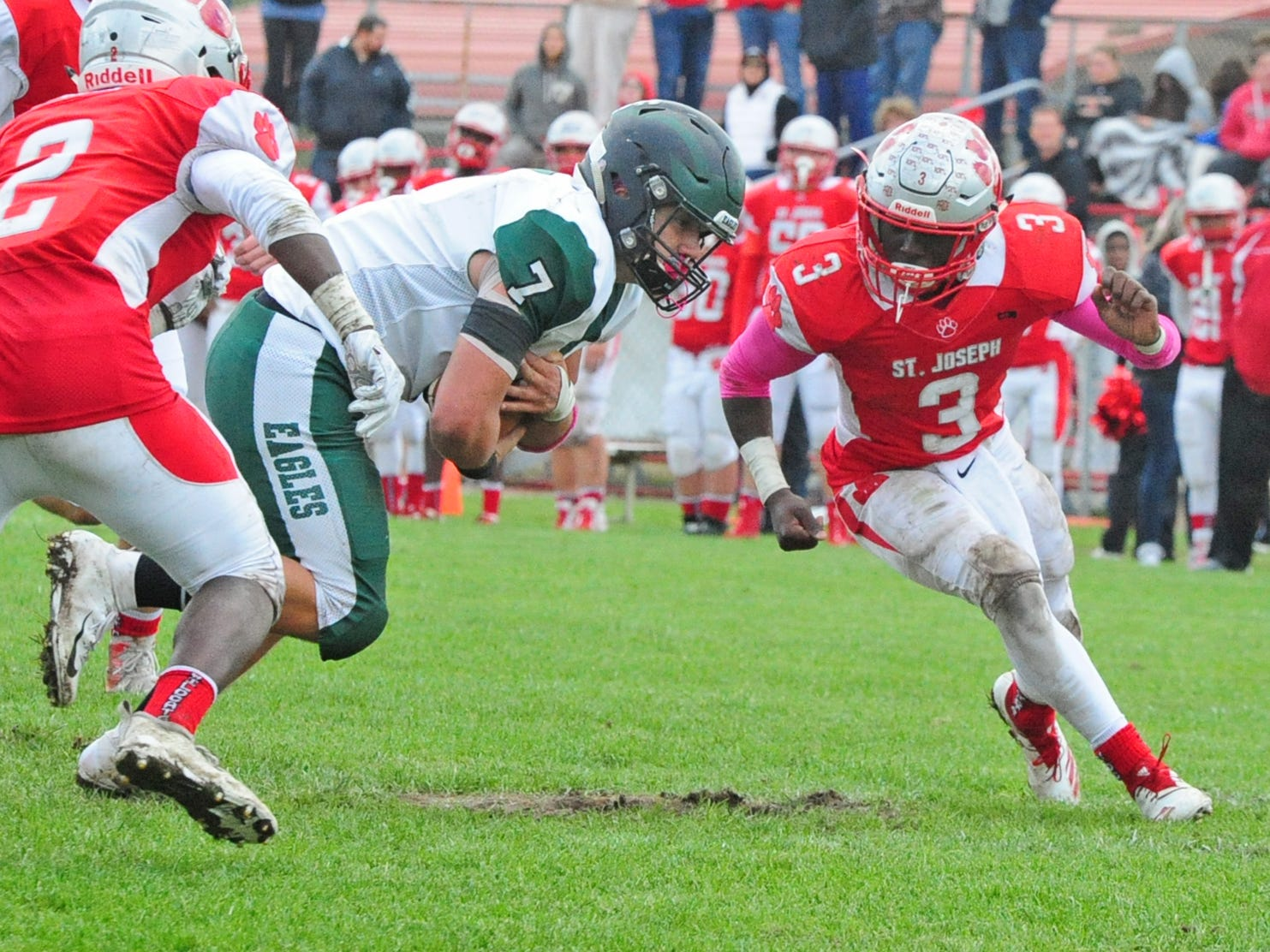 West Deptford's T.J. Hoyt (center) is defended by St. Joseph's Jada Byers (right) during Saturday's football game in Hammonton on October 13, 2018.