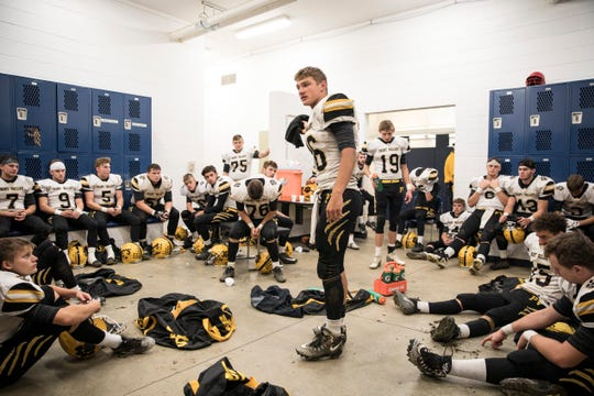 Paint Valley's Lane Mettler talks to team in locker room during a 35-27 win at Southeastern High School in 2018.
