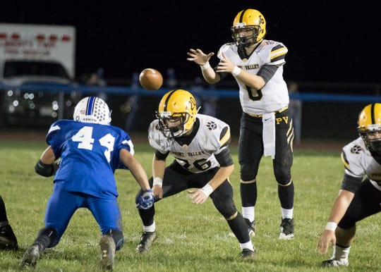Paint Valley quarterback Bryce Newland takes a snap against Southeastern as the Bearcats went on to win 35-27.