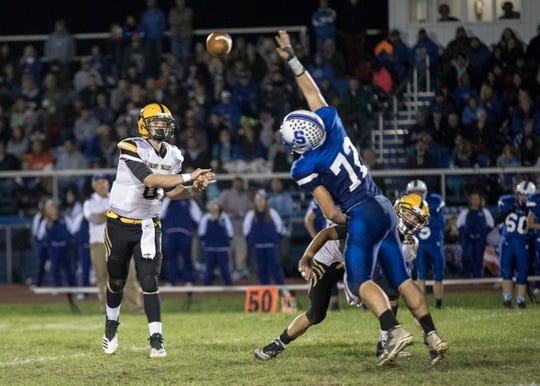 Paint Valley quarterback Bryce Newland throws the ball in a 35-27 win over Southeastern at Southeastern High School in 2018.