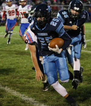 Adena's Carson Long rushes for a TD during the first half Friday night against ZT.  The Warriors are one of several local teams that will likely end up in the postseason football playoffs.