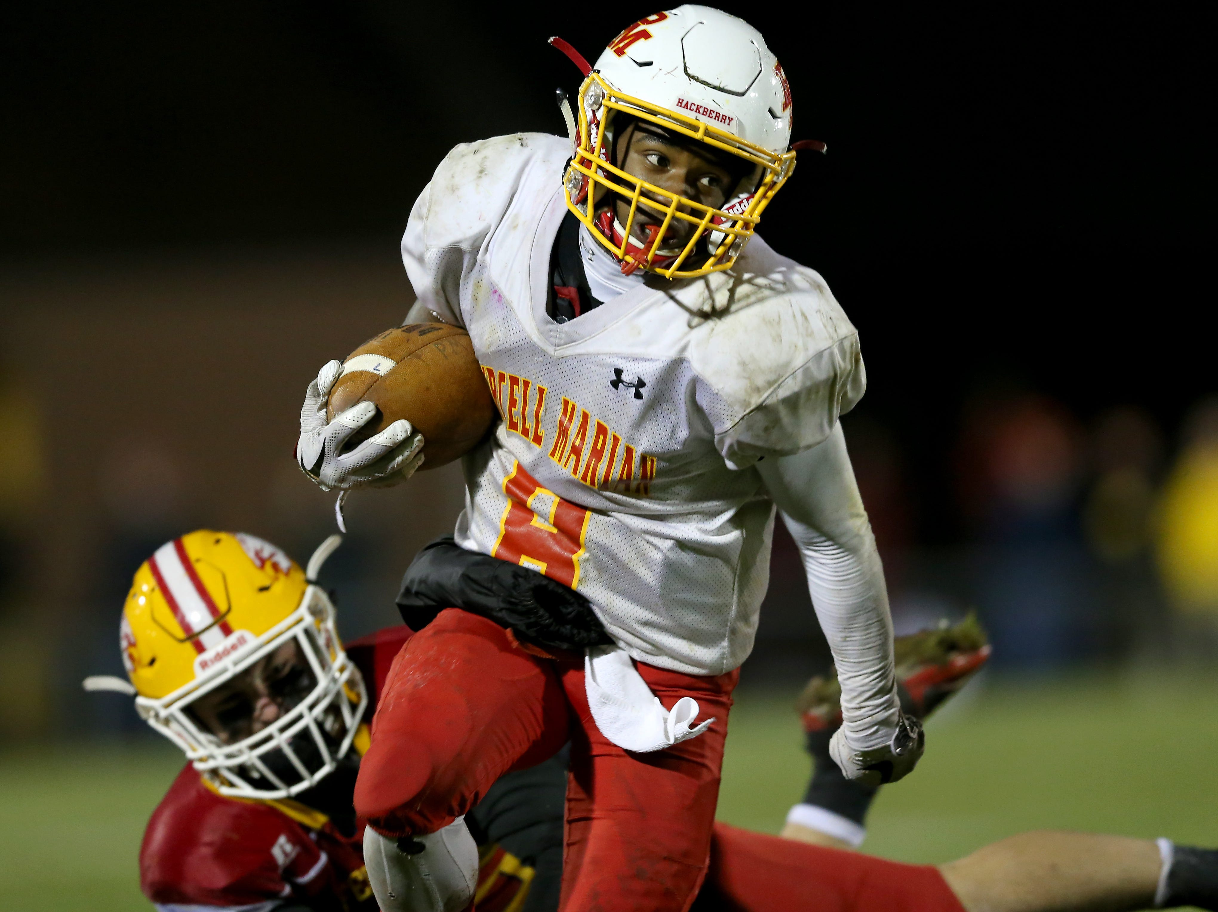 Purcell Marian running back Torrence Johnson (8) carries the ball in the third quarter during a high school football game between Purcell Marian and Bishop Fenwick, Friday, Oct. 12, 2018, at Bishop Fenwick High School in Middletown, Ohio.