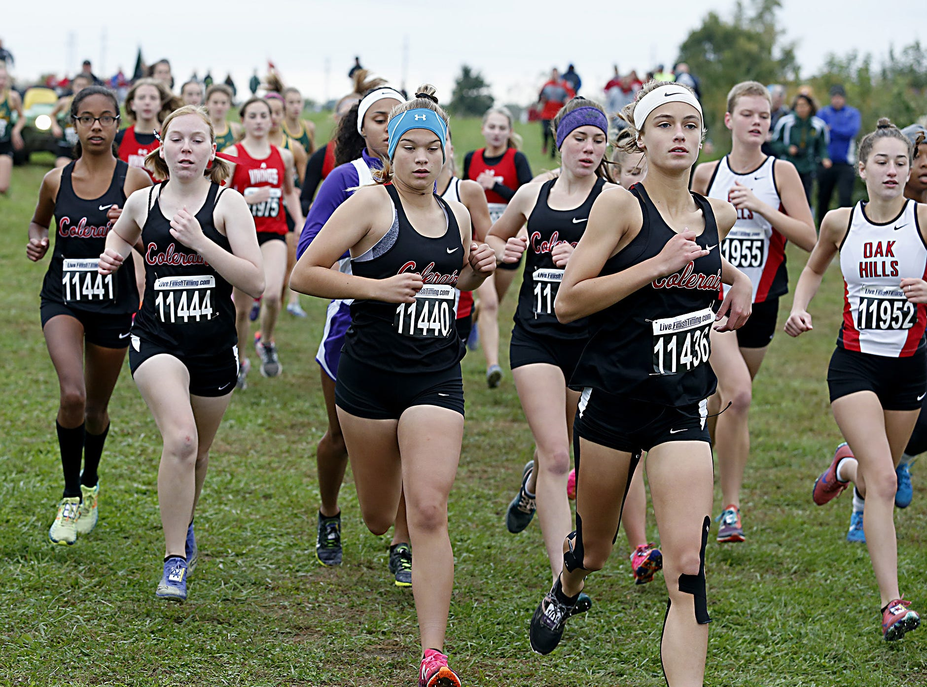 The Colerain girls run together during the Greater Miami Conference Girls and Boys Cross Country Championships at Voice of America Park in West Chester Saturday, Oct. 13, 2018.