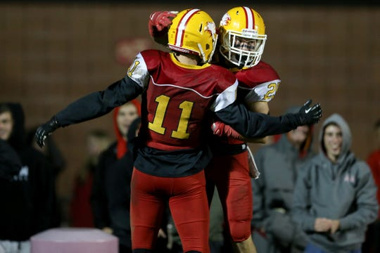 Bishop Fenwick wide receiver David Schu (25) celebrates a touchdown catch and run with wide receiver Thomas Vogelsang (11) in the third quarter during a high school football game between Purcell Marian and Bishop Fenwick, Friday, Oct. 12, 2018, at Bishop Fenwick High School in Middletown, Ohio.