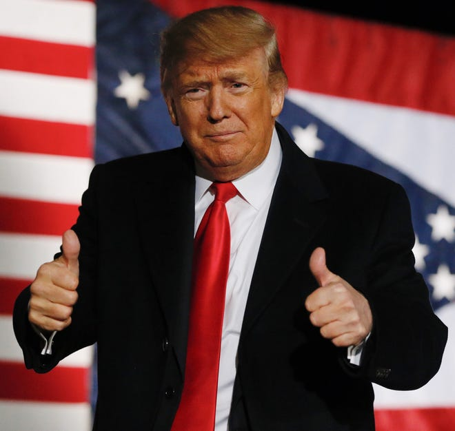 President Donald Trump gives a thumbs-up at the end of his speech on Oct. 12 in Lebanon.