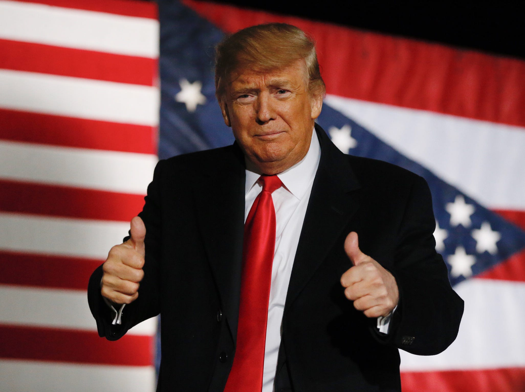President Donald Trump gives a thumbs-up at the end of his speech.