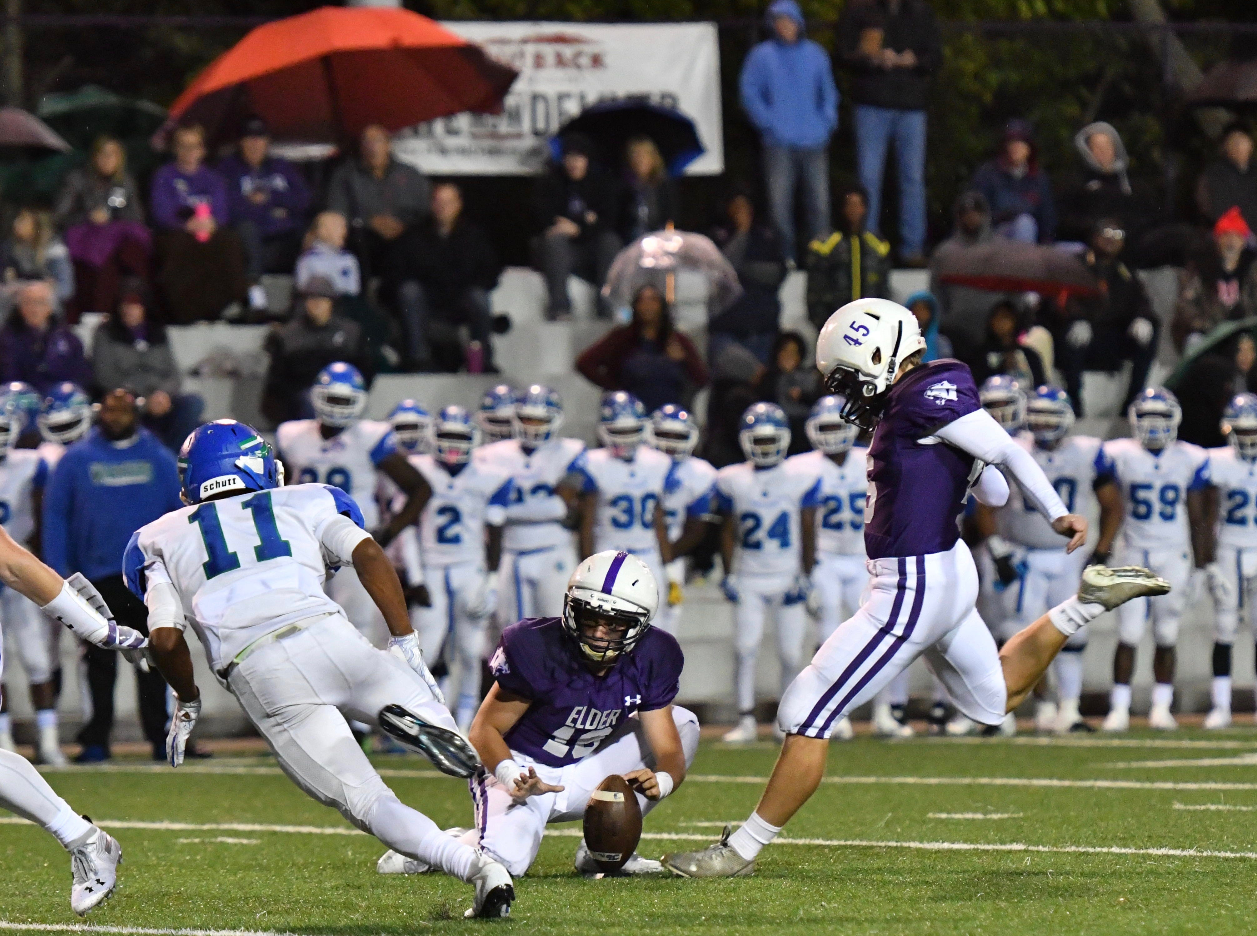 Elder kicker Sam Harmeyer drills a 28-yard field goal in the first half against Winton Woods Friday, Oct. 12, 2018.