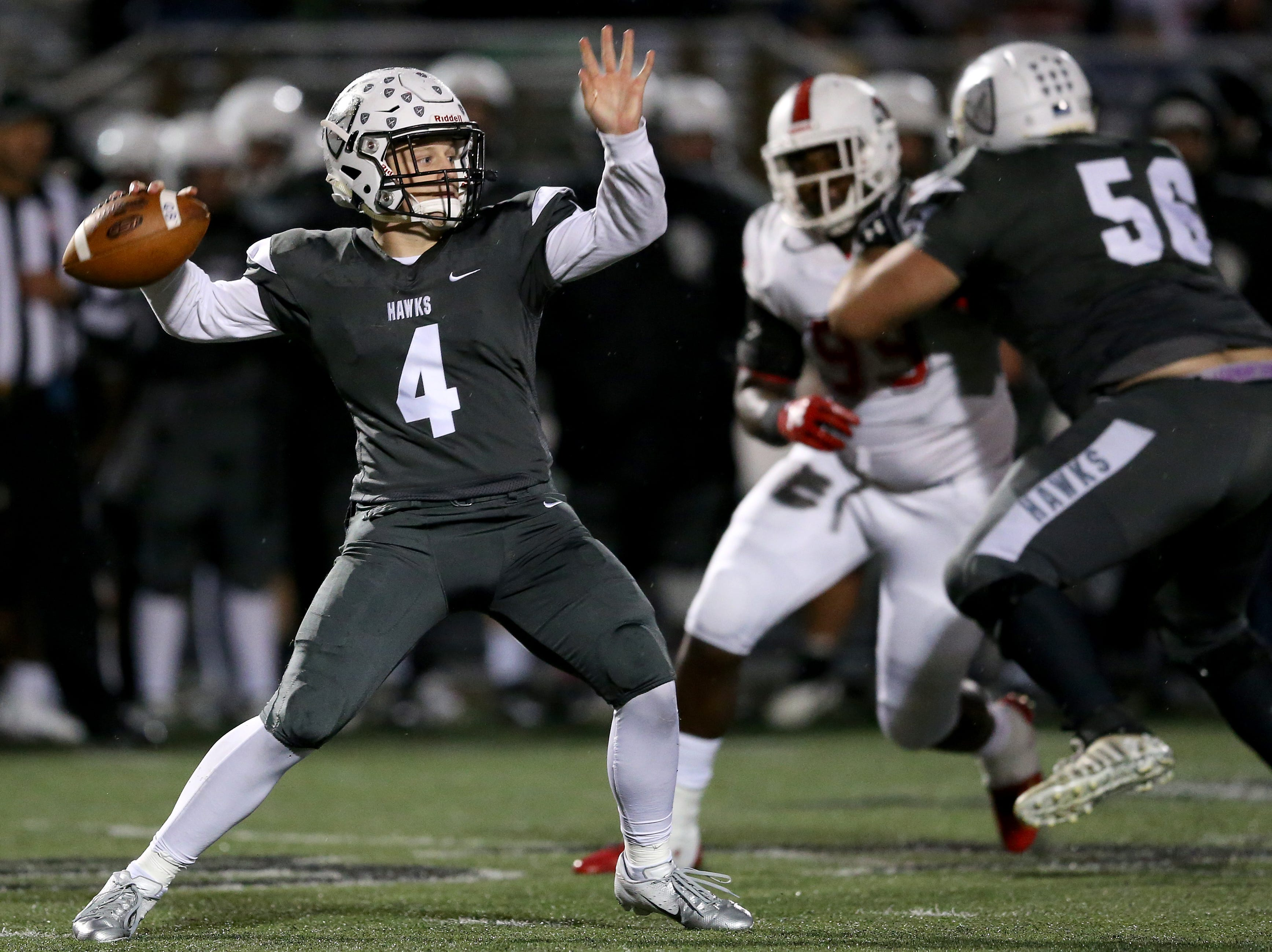 Lakota East Thunderhawks quarterback Sean Church (4) throws in the first quarter during a high school football game between the Colerain Cardinals and the Lakota East Thunderhawks, Friday, Oct. 12, 2018, at Lakota East High School in Liberty Township, Ohio.