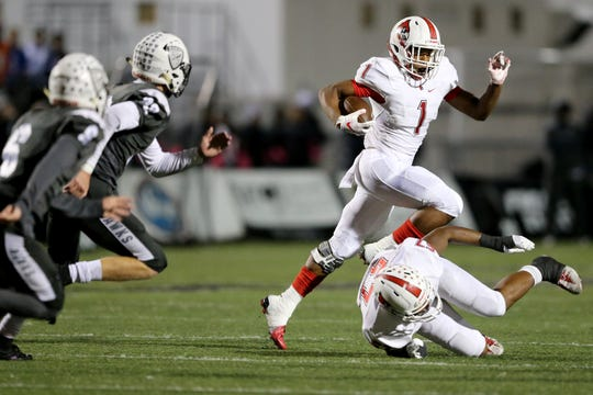 Colerain Cardinals running back Syncere Jones (1) leaps over a teammate on a carry in the first quarter during a high school football game between the Colerain Cardinals and the Lakota East Thunderhawks, Friday, Oct. 12, 2018, at Lakota East High School in Liberty Township, Ohio.