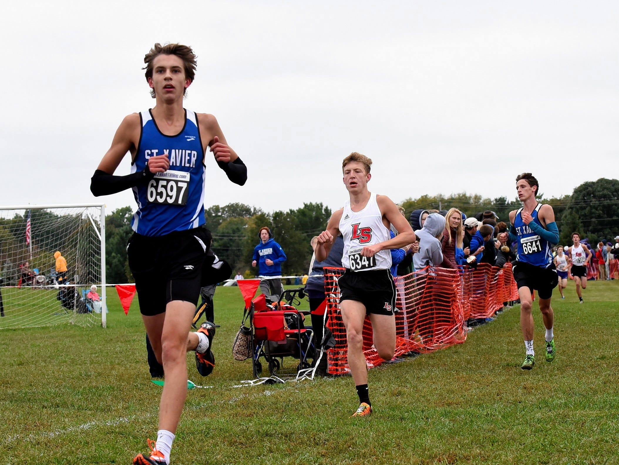 St. Xavier's Nick Mills, Ryan Crail of La Salle and Thomas Walters of St. Xavier finish 6,7 and 8 at the 2018 GCL/GGCL Cross Country Championships, October 13, 2018.