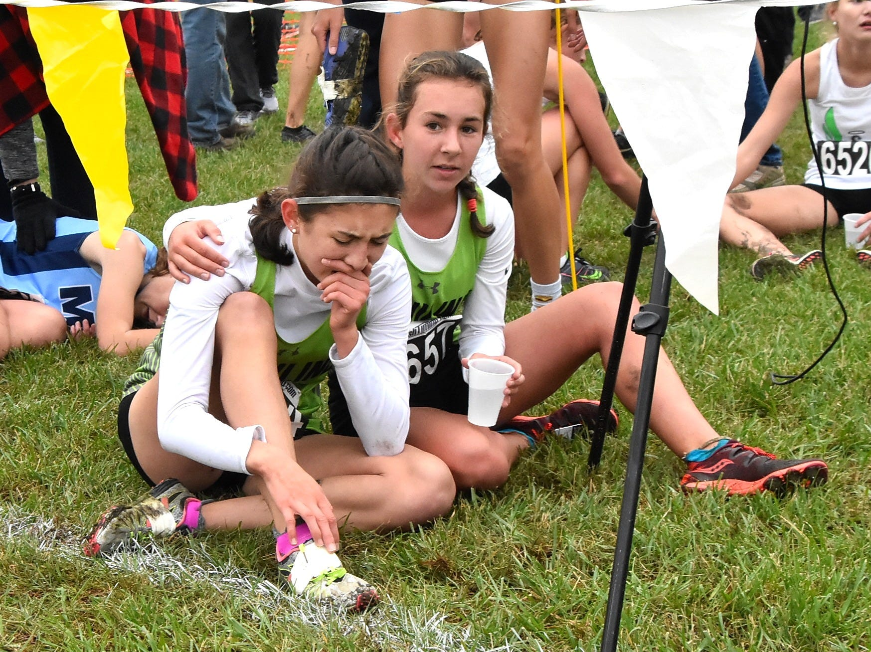Ursuline runners share a moment of consolation after running at the 2018 GCL/GGCL Cross Country Championships, October 13, 2018.