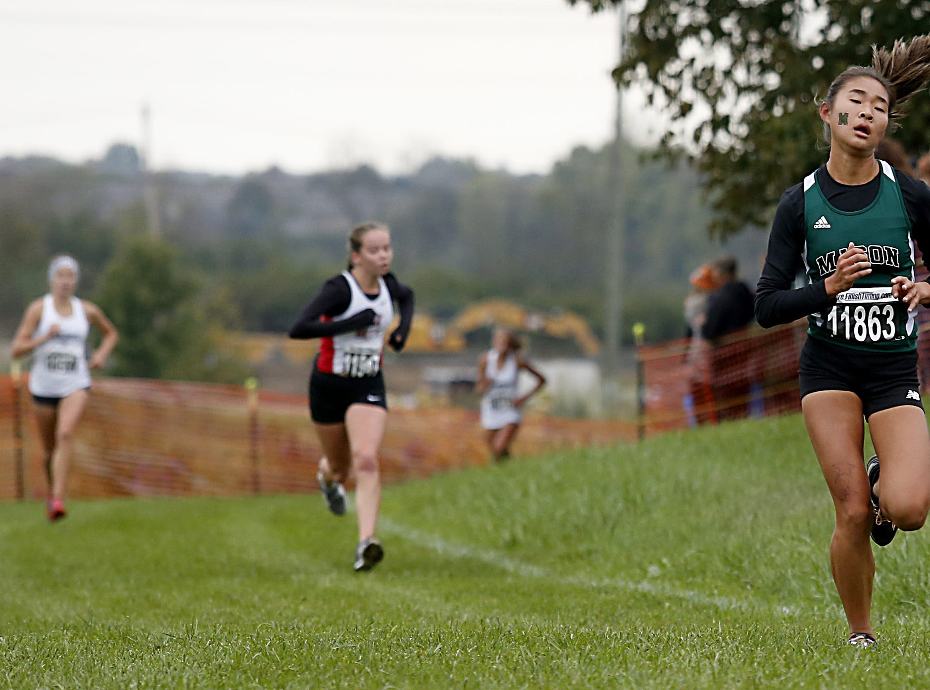 Mason's Faith Min finishes fourth during the Greater Miami Conference Girls and Boys Cross Country Championships at Voice of America Park in West Chester Saturday, Oct. 13, 2018.