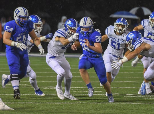 Joe Buten (26) of Highlands runs the ball through the Covington Catholic defense, Highlands High School, Ft. Thomas, KY, Friday, October 12, 2018