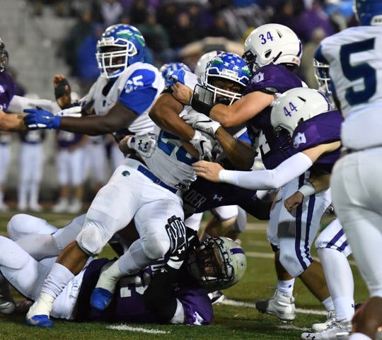 Winton Woods' Miyan Williams rushes for a first down against Elder Friday, Oct. 12, 2018.