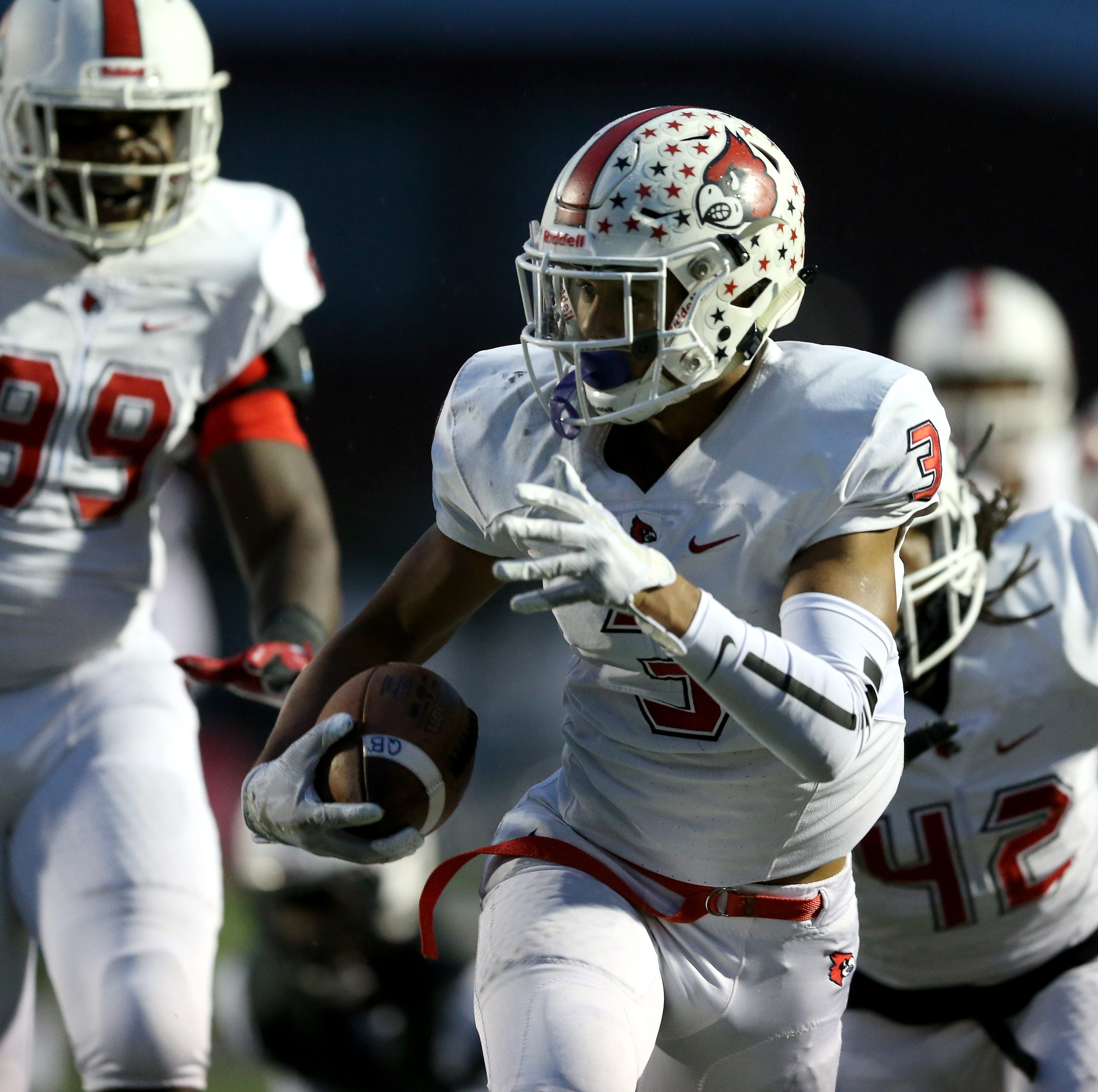 Colerain Cardinals defensive back Deshawn Pace (3) returns a fumble for a touchdown in the first quarter during a high school football game between the Colerain Cardinals and the Lakota East Thunderhawks, Friday, Oct. 12, 2018, at Lakota East High School in Liberty Township, Ohio.