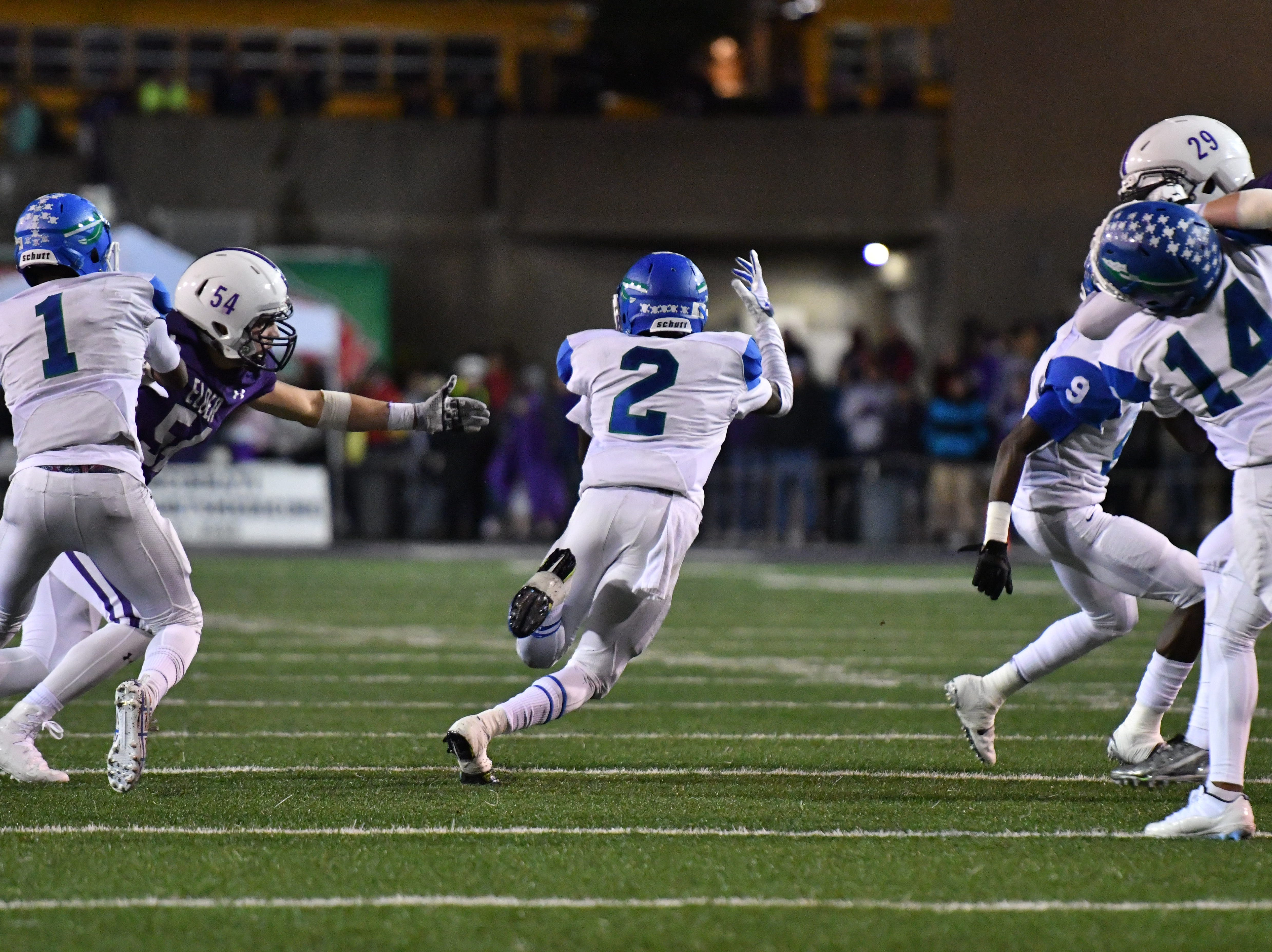 Winton Woods' Raequan Prince finds a huge lane to run through against Elder Friday, Oct. 12, 2018.