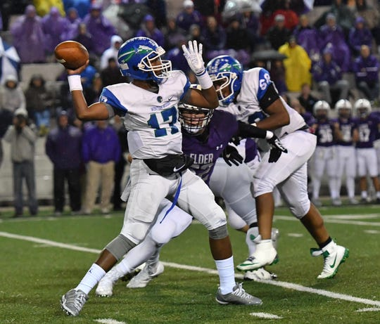 Winton Woods' MiChale Wingfield launches a deep pass against Elder Friday, Oct. 12, 2018.