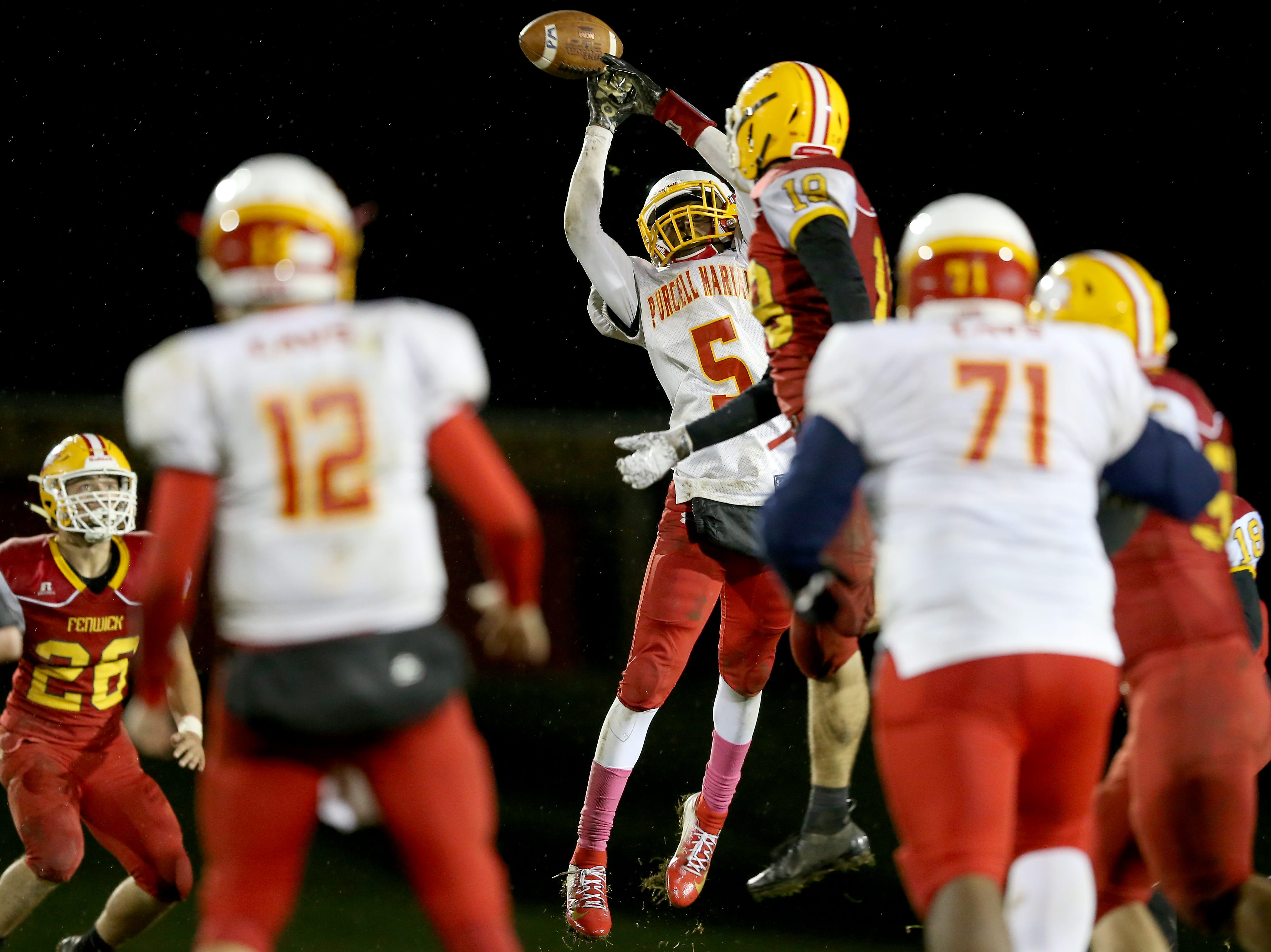 Purcell Marian wide receiver Daijon Jackson (5) leaps for a pass in the third quarter during a high school football game between Purcell Marian and Bishop Fenwick, Friday, Oct. 12, 2018, at Bishop Fenwick High School in Middletown, Ohio.