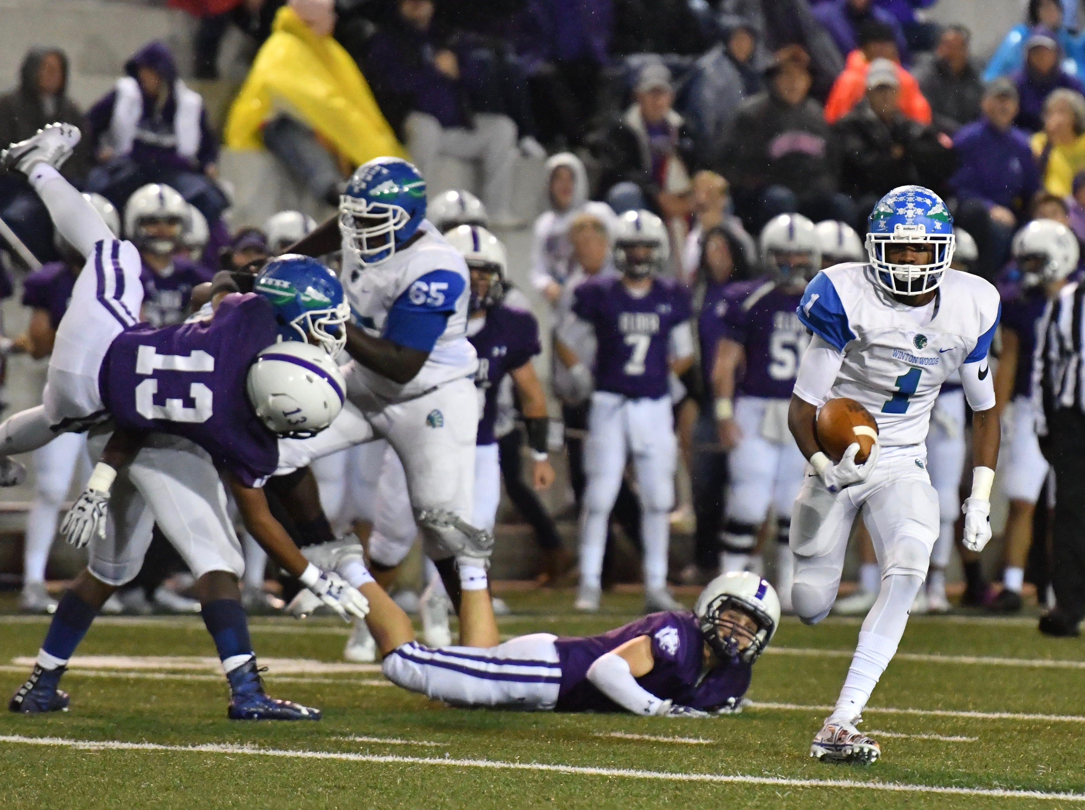 Winton Woods' Demeer Blankumsee scores a wild touchdown in the first half against Elder, however, a holding penalty against Winton Woods would bring the ball back Friday, Oct. 12, 2018.
