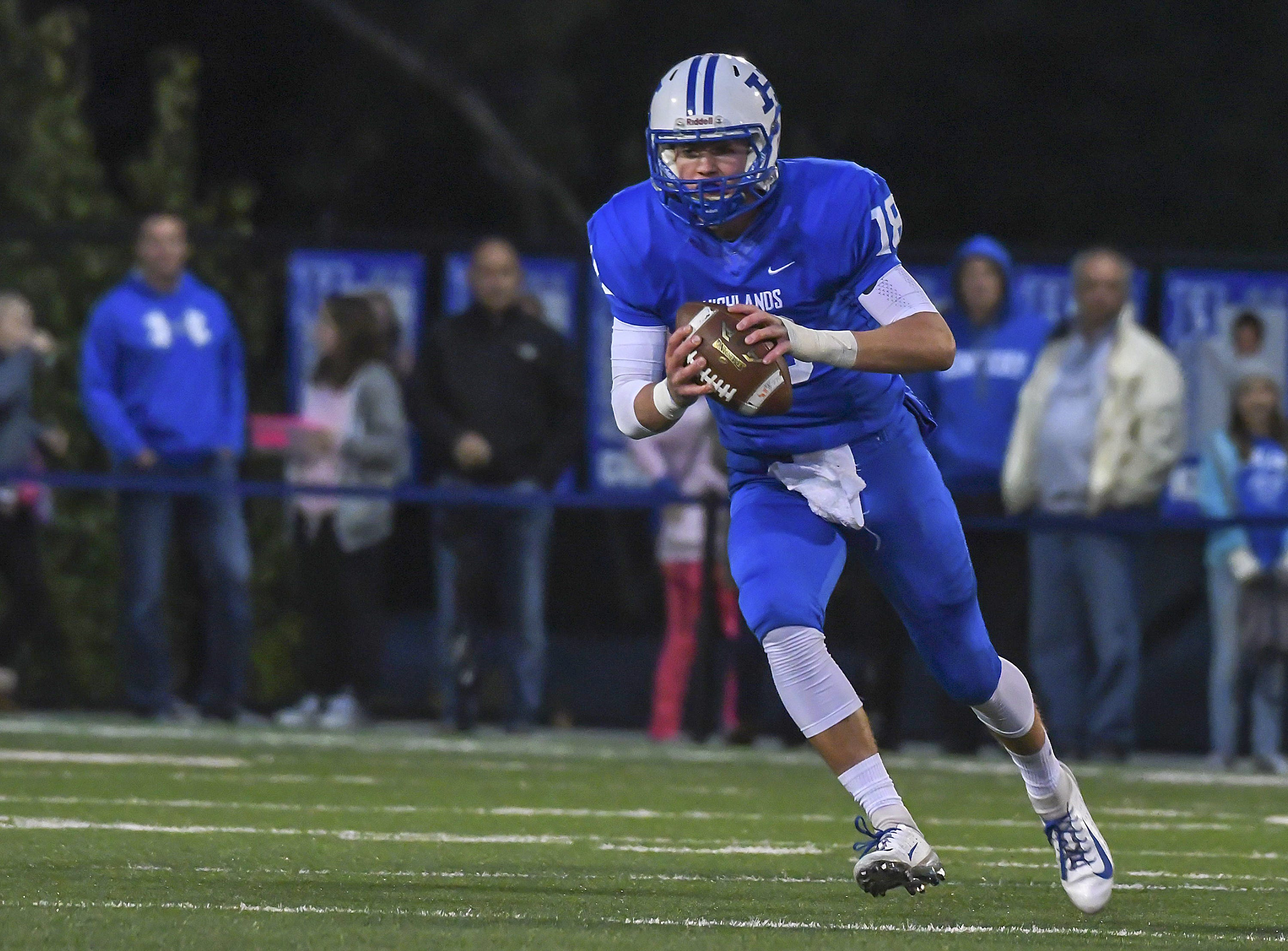 Bluebirds quarterback Grady Cramer runs the ball against the Colonels, Highlands High School, Ft. Thomas, KY, Friday, October 12, 2018