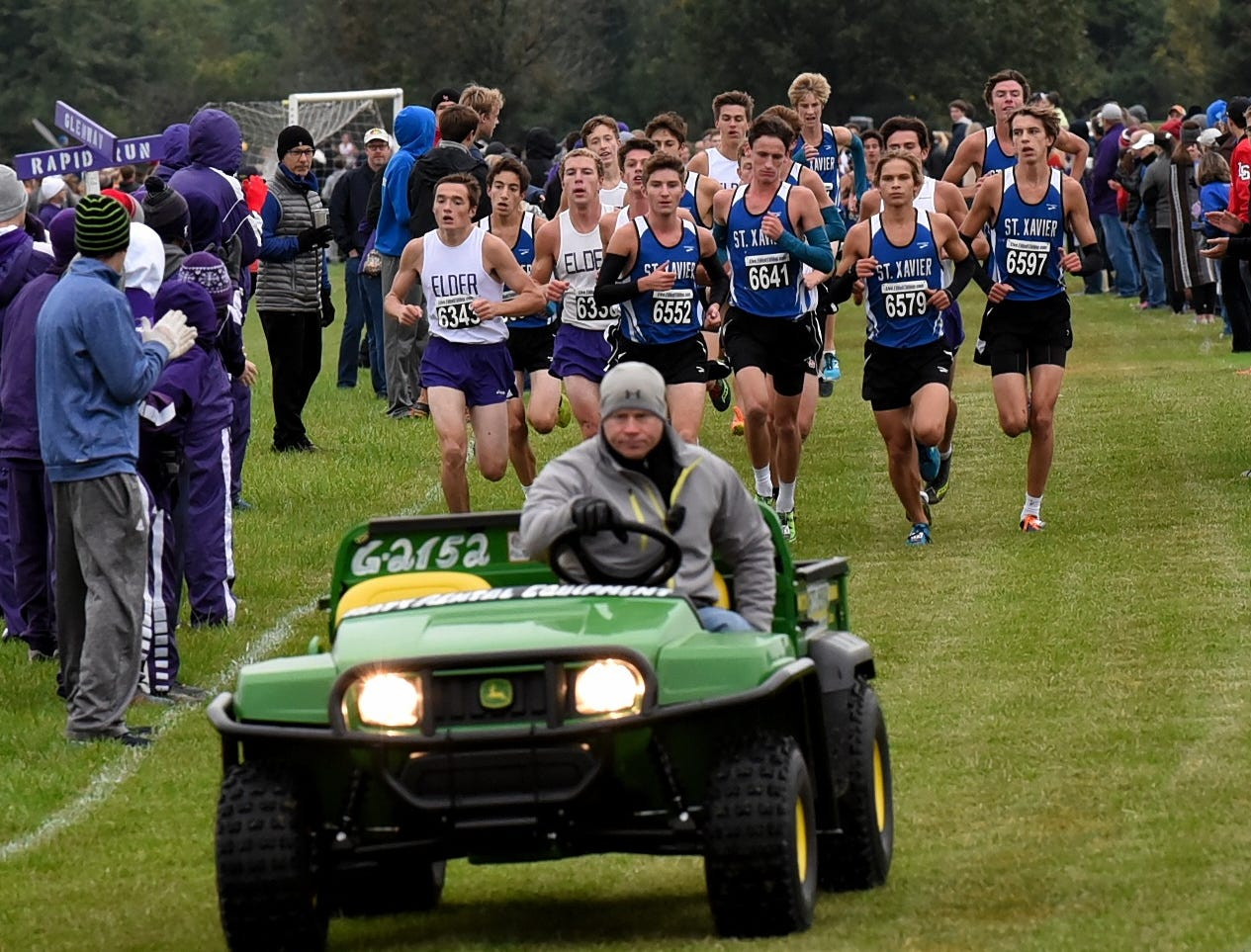 The lead vehicle guides the GCL cross country runners at the 2018 GCL/GGCL Cross Country Championships, October 13, 2018.