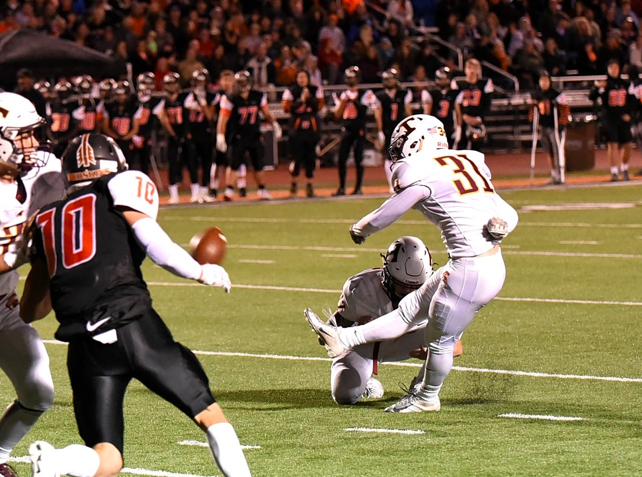 Miles Molloy (31) drives home a field goal for Turpin late in the first half, October 12, 2018.