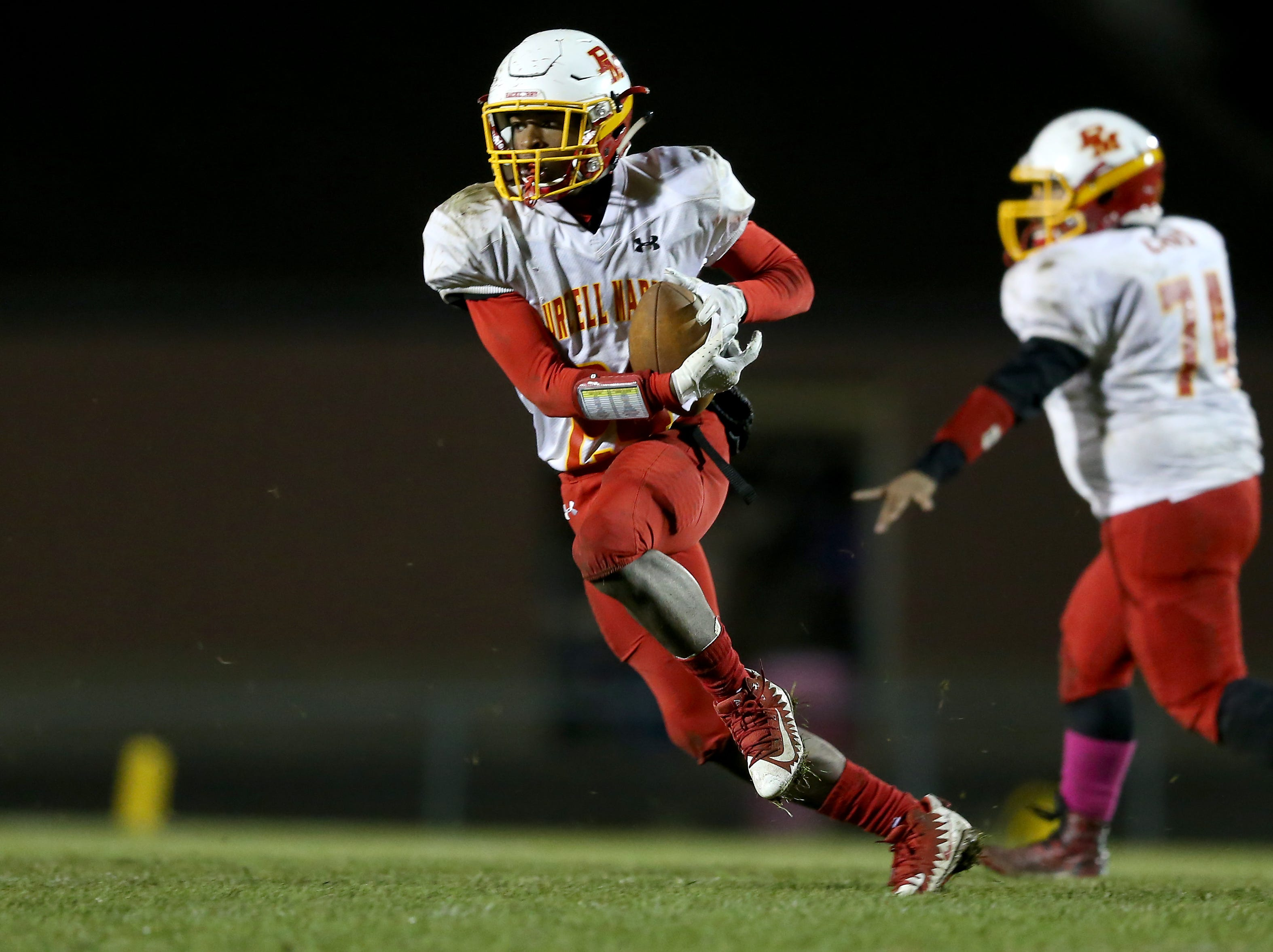 Purcell Marian wide receiver Artrimus Santor (25) catches a pass in the fourth quarter during a high school football game between Purcell Marian and Bishop Fenwick, Friday, Oct. 12, 2018, at Bishop Fenwick High School in Middletown, Ohio.