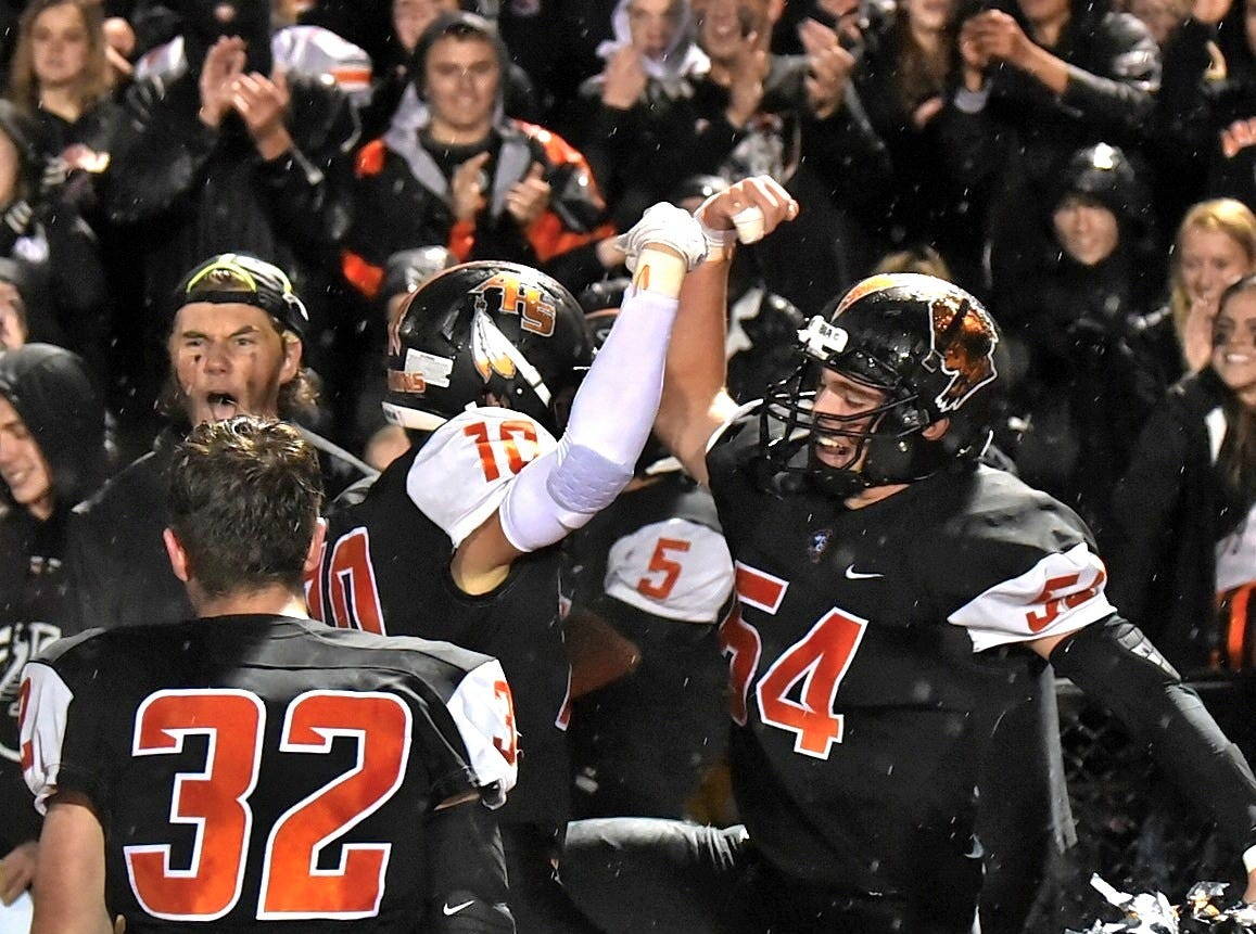 The Anderson Redskins celebrate their come-from-behind 42-24 win over Turpin, October 12, 2018.