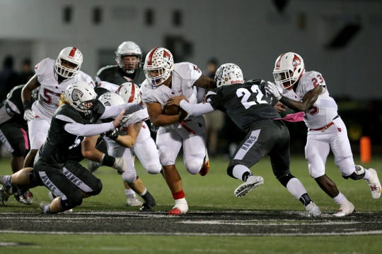 Colerain Cardinals running back Ivan Pace Jr. (5) carries the ball in the first quarter during a high school football game between the Colerain Cardinals and the Lakota East Thunderhawks, Friday, Oct. 12, 2018, at Lakota East High School in Liberty Township, Ohio.