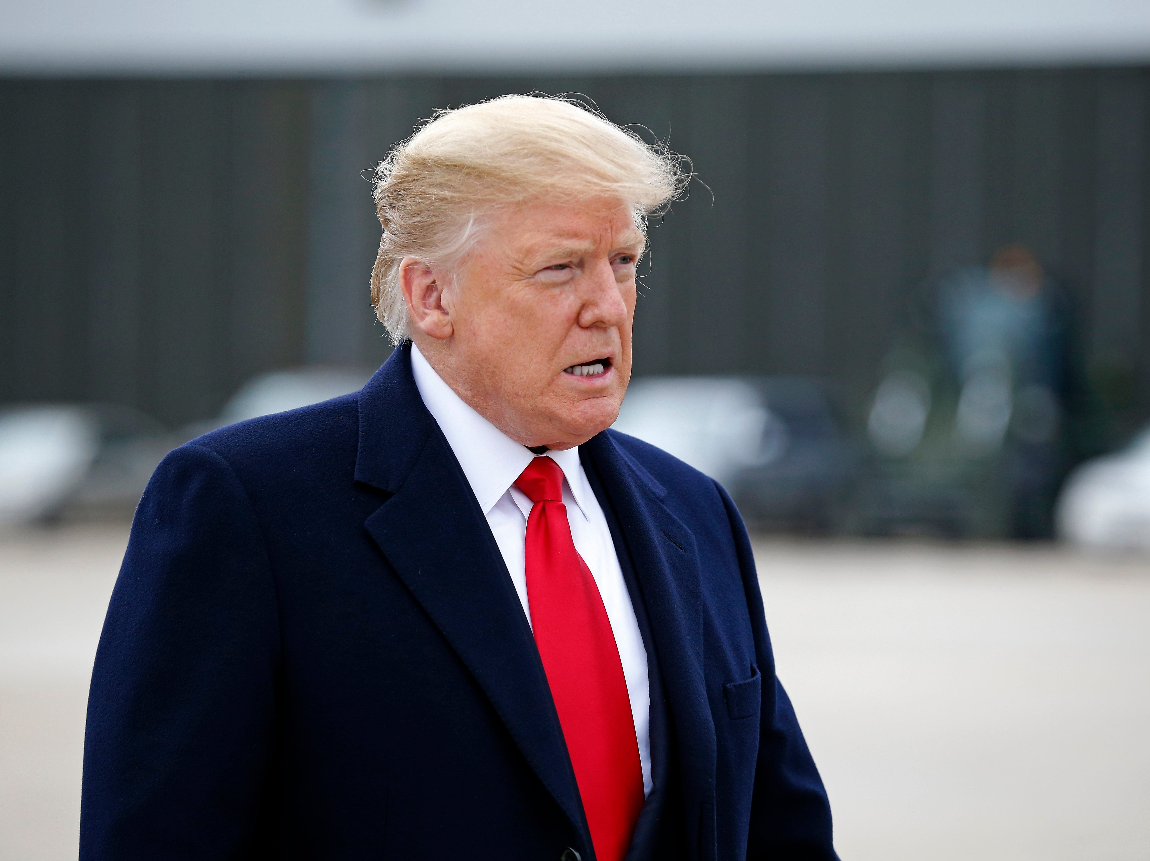 President Donald Trump makes his way to a gathering of reporters next to Air Force One at Lunken Airport in Cincinnati on Friday, Oct. 12, 2018. President Trump visited the Cincinnati area for a MAGA Rally at the Warren County Fair Grounds in Lebanon, Ohio, Friday night.